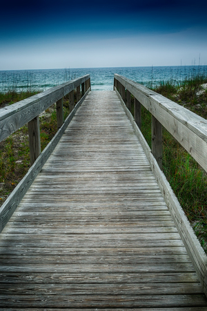 Long boardwalk leading out to the Atlanic Ocean  photo