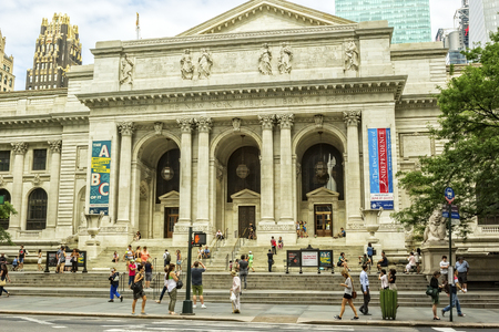 boroughs: New York, NY - June 23, 2014: The New York Public Library, located on 5th Ave at 42nd St, is the second largest public library in the United States.  The library originated in the 19th century, and has branches in the boroughs of Manhattan, The Bronx and