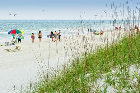 Atlantic Beach, FL - May 23, 2014:  Beach goers enjoy a day on the beach during the summer months at Atlantic Beach near Jacksonville, Florida. Editorial