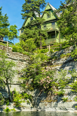 nestled: Mohonk Mountain House, old fashioned hotel nestled in the Shawangunk Mountains, New Paltz, New York.