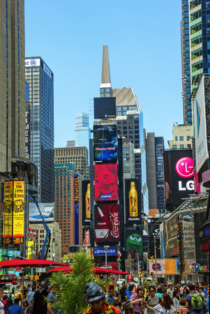 New York, NY - June 24, 2014: New York City's Times Square, the junction of Broadway and 7th Avenue, is now one of the busiest pedestrian intersections and major center for worldwide entertainment.