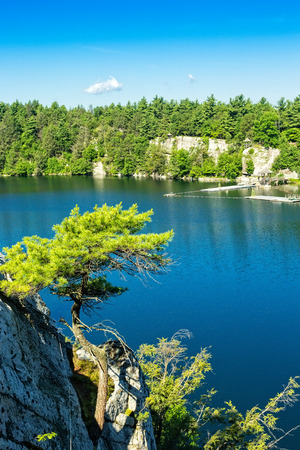 nestled: Mohonk lake, nestled in the Shawangunk Mountains and surrounded by dense forests and nature in New Paltz, New York.