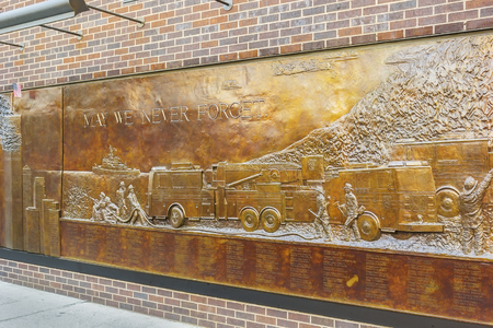 world trade center: New York, NY - June 23, 2014: The Memorial Wall is located at FDNY Engine 10 Ladder 10, directly across from the World Trade Center site.  Its dedicated to the 343 members of the NYFD who died on 911.