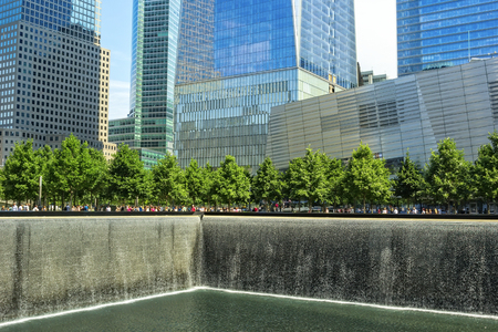 9 11: New York, NY - June 23, 2014  The 9 11 Memorial, in New York City, consists of two pools with 30 ft waterfalls   Victims names are inscribed in the bronze parapets surrounding the pools