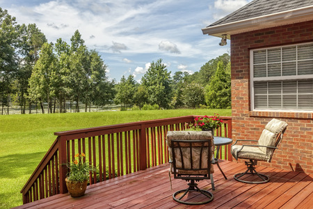 Residential backyard deck with a scenic view of lake. Stock Photo