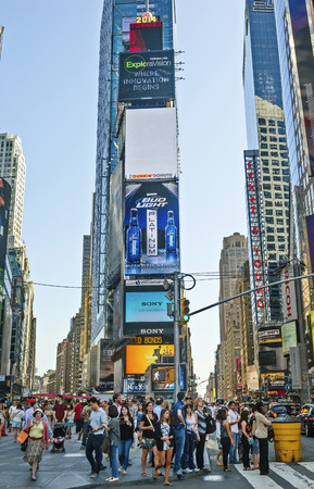 New York, NY - June 24, 2014:  Pedestrians fill NYCs Times Square, the junction of Broadway and 7th Avenue, and the center for worldwide entertainment. Editorial