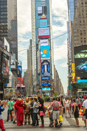 disney cartoon: New York, NY - June 24, 2014:  Cartoon characters in Times Square pose with tourists and entertain the thousands of visitors that fill New York City.