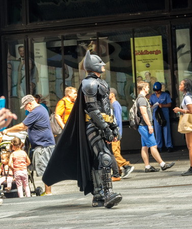 batman: New York, NY - June 24, 2014:  Man, dressed up as Batman character, in Times Square to pose with tourists and entertain the thousands of visitors that fill New York City.
