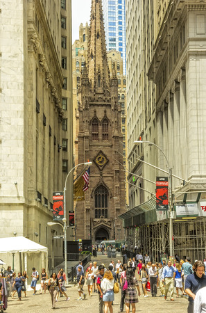 trinity: New York, NY - June 23, 2014: Trinity Church, built in 1846, and located at Broadway and Wall streets, is a historic and functioning parish church in the Episcopal Diocese of New York. Editorial