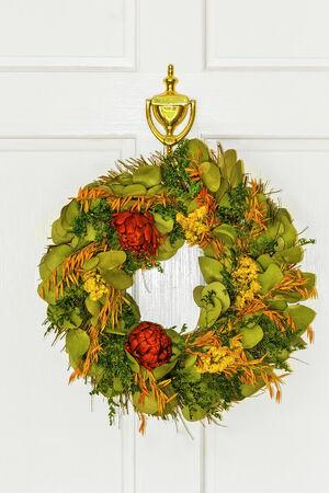 Autumn wreath on white front door photo