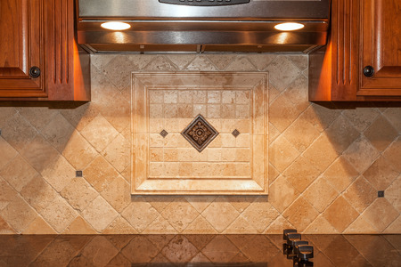 Traditional kitchen with stone backsplash and granite countertop photo