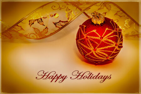 A Merry Christmas card, with text, and a red ornament ball with a vintaged tone Stock Photo - 33981282