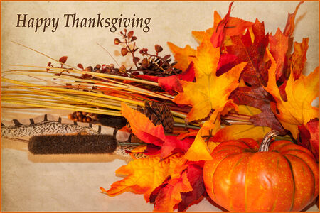 A Happy Thanksgiving card, with autumn decorations and text
