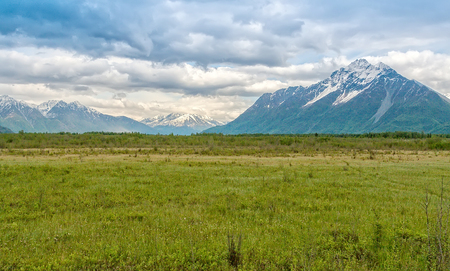 Mountain ranges and open countryside are what makes up the beauty of Alaska Stock Photo