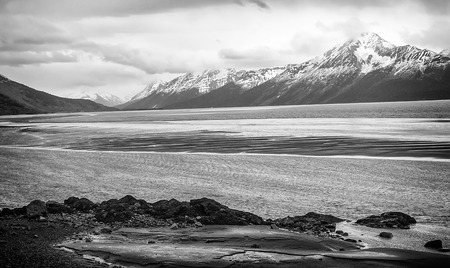 Alaskas scenic landscape, the snow capped mountains and rivers that run along the shore near Anchorage. photo