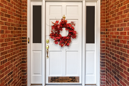 Red Autumn wreath on front door walkway