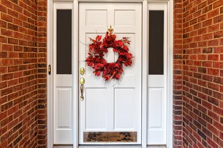 Red Autumn wreath on front door walkway