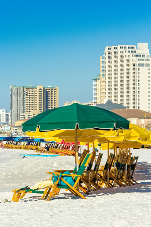 amenities: Destin, FL - Oct. 25, 2014:  Miramar Beach, in Destin, Florida, filled with beach chairs and umbrellas has ultra-modern amenities and activities that are ideal for family fun. Stock Photo