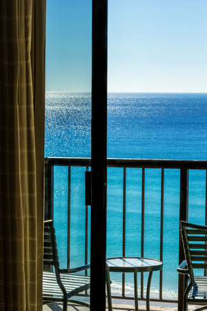 destin: Balcony overlooking Gulf of Mexico in Destin, Florida through sliding glass door.