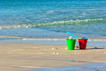 destin: Childs toy bucket on Miramar Beach in Destin, Florida, along the Gulf of Mexico