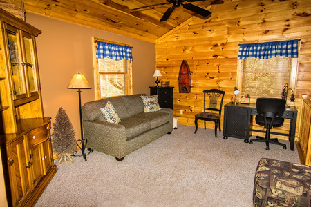 Interior of log cabin, loft with seating area, overlooking downstairs seating area