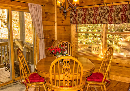 dining area: Dining area in Log Cabin in North Carolina Stock Photo