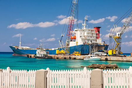 cayman: Barge anchored at commercial dock in Grand Cayman, Cayman Islands Stock Photo
