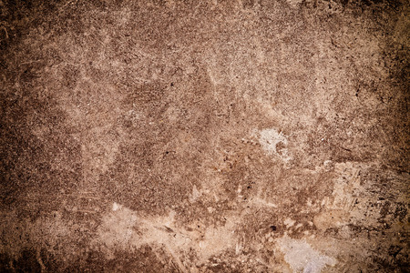 Brown textured grungy background with slight vignette applied