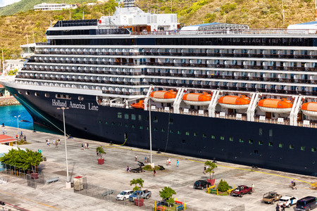 anchoring: Charlotee Amalie, St. Thomas - Jan. 15, 2013:  Holland America cruise ship anchored in St. Thomas, USVI, a popular cruise destination.  Charlotte Amalie is both the principle cruise terminal as well as the island's airport location.