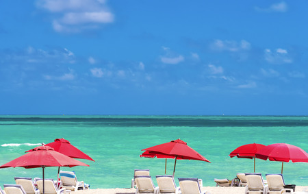 south miami: Row of red beach umbrellas on south Miami Beach, Florida, USA