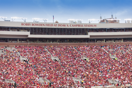 Tallahassee, FL - Nov. 23, 2013:  FSU fans at a Seminole home football game at Doak S. Campbell Stadium in Tallahassee, Florida.  The stadium was named for Doak S. Campbell, the president of the university at the time of its construction, and the field wa