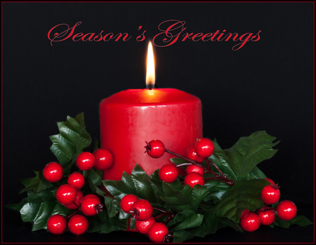 greetings card: Seasons  Greetings card with red candle and holly branches. Stock Photo