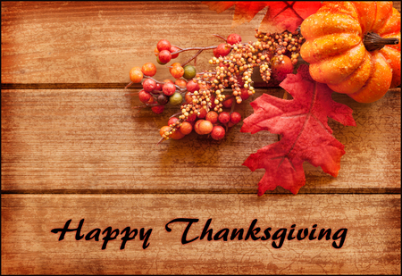 Happy Thanksgiving greeting card with text and autumn arrangement.