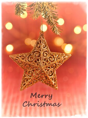 Gold glittery star with soft bokeh lights in background with soft border and Merry Christmas text