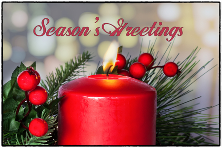 greetings card: Seasons Greetings card with red candle decoration, holly evergreen and text