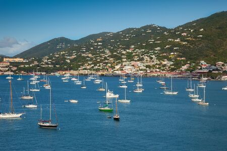 thomas: Harbor in St. Thomas, U.S. Virgin Islands, with sailboats and tropical island.