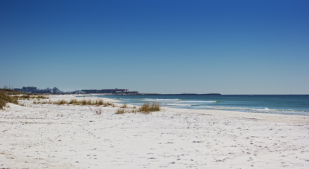 destin: Long stretch of Destin beach and the Gulf of Mexico in Destin, Florida