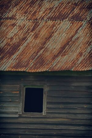 roof windows: Old building with grunge and HDR effect applied. Stock Photo