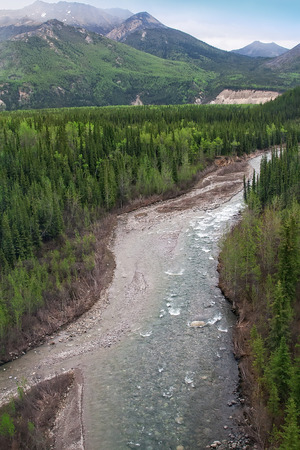Scenic landscape of Alaskas flowing rivers through valleys and mountain ranges.