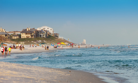 destin: Destin, FL - June, 25, 2013:  Crowded beach and coastline in Destin, Florida. Destin is located on Florida�s Emerald Coast, which gets its name from its beautiful, clear green water.