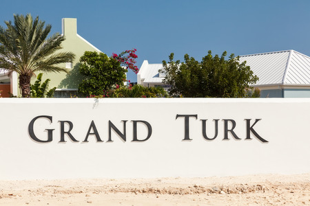 turk: Grand Turk, Turks & Caicos Islands - Feb. 12, 2010:  Entry into Grand Turk indicated by the large white wall with the Grand Turk letters.  Grand Turk is the largest island in the Turks and Caicos islands, and a destination for many cruise ships.
