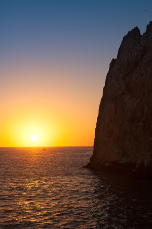 lucas: Sun setting on the horizon in Cabo San Lucas at the natural rock formation, Lands End.