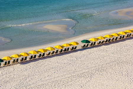 destin: Row of empty beach chairs and umbrellas on Destin Beach, Florida