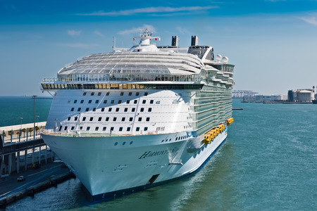 seas: Barcelona, Spain - June 7, 2016:  Royal Caribbeans, Harmony of the Seas, is now the largest ship in the world, with a gross tonnage of 226,963. Stock Photo