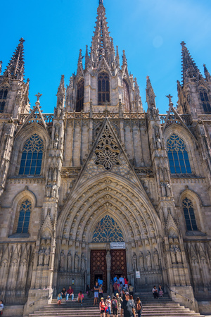 Barcelona, Spain - June 19, 2016: Tourists at the Cathedral of Barcelona, a Gothic cathedral and home of the Archbishop of Barcelona, was constructed from the 13th to 15th centuries. Editorial