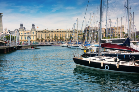 Barcelona, Spain - June 6, 2016: Port Vell (Old Harbor) in Barcelona, Spain is a waterfront marina.  It was built as part of an urban renewal program prior to the 1992 Barcelona Olympics. Editorial