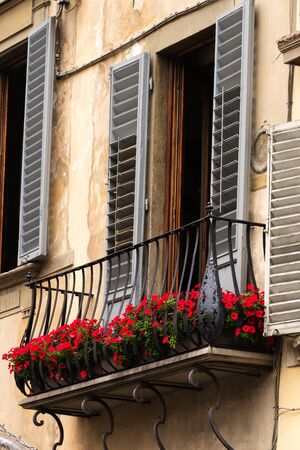italian architecture: Ancient Italian architecture and colorfully decorative balcony in Florence, Italy.