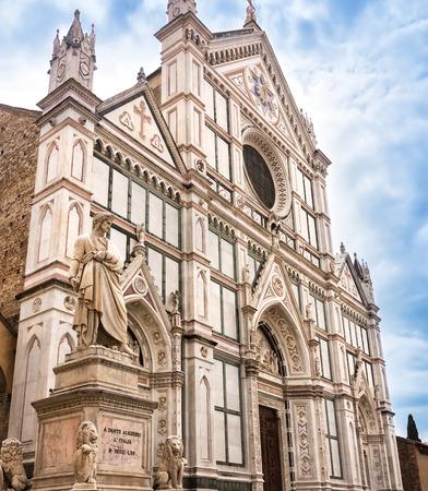 dante alighieri: Statue of Dante Alighieri, in the Piazza Santa Croce, besides the Basilica of Santa Croce in Florence, Italy. Stock Photo