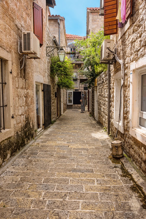 decorative balconies: Historic architecture, narrow stone wakways, and decorative balconies in Kotor, Montenegro.