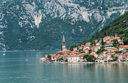 view on sea: Picturesque view of the coastline of the historic old town of Perast, Montenegro. Stock Photo